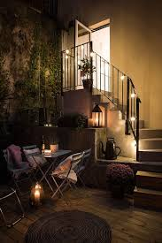 perfect cozy terrace with string lights apartment lighting ideas