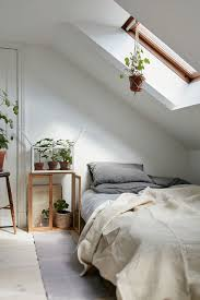 attic bedroom in a charming plant filled attic apartment in sweden gravity home bedroom home amazing attic ideas charming