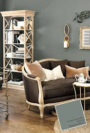 furniture living room wall: im less a fan of the wall color and more a fan of the settee bookshelf and bar cart
