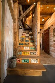 vintage license plates add pops of color to the staircase that leads to the loft area bedroomknockout carpet basement family