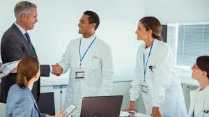 does a professional science master s degree pay off science aaas scientists and business people talking in conference room