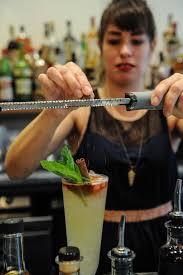 take a first look at amer cocktail bar in inman park atlanta bar manager shanna o finishes the smoke chill cocktail mezcal pineapple banana