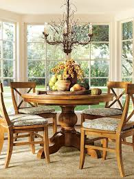 pottery barn style dining table: a round dining table with a bountiful centerpiece