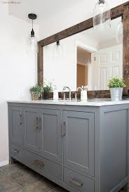 bathroom features gray shaker vanity: the natural wood in this bathroom adds texture and a bold look to this bathroom many farmhouse bathrooms feature large window usually placed abo