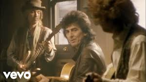 The <b>Traveling Wilburys</b> - End Of The Line (Official Video) - YouTube