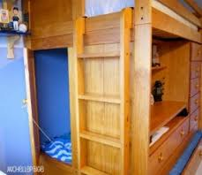 a bunkbed with a trundle bed a pull out desk a bunk bed dresser desk