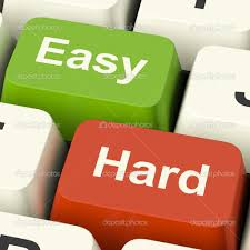 hard easy computer keys showing the choice of difficult or simpl hard easy computer keys showing the choice of difficult or simple ways photo by stuartmiles