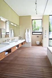 dwell bathroom cabinet:  examples of bathroom vanities that have open shelving this spa style bathroom has