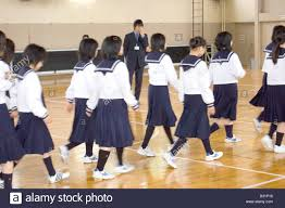 ese junior high school students pose next to girl in maiko students in classroom middot ese junior high school students walk across a gymnasium floor stock photo