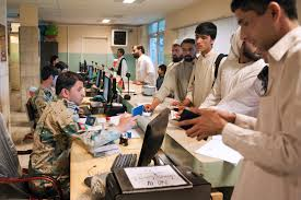 u s department of defense photo essay afghan customs officials check passports at the customs checkpoint at torkham gate in s nangarhar province