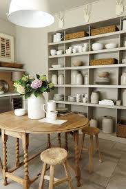 dining table parson chairs interior: beautiful dining room features farmhouse dining table lined with slipcovered linen dining chairs below a linear lantern pendant hung from vaulted tongue and