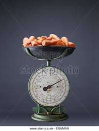 vintage kitchen food weighing scales fresh carrots on top of vintage kitchen scales stock image