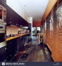 Slate Flooring For Kitchen Slate Floor And Wooden Venetian Blinds In Modern Galley Kitchen