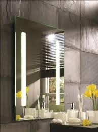 bathroom mirror cabinets with built in lights provides a glamorous spot to put on make up or the perfect place to shave this slick design creates soft bathroom makeup lighting