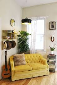 living room furniture spaces inspired: a beautiful mess fiddle leaf fig and organized personal items