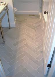 ceramic tile for bathroom floors: bathroom flooring light tile in herringbone pattern