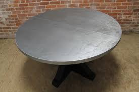 person dining room table foter: round zinc table lake and mountain home