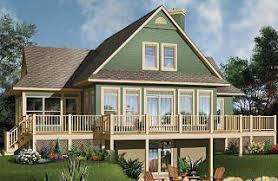 Sloping and Hillside Designs from DrummondHousePlans comThe Pocono Open floor plan chalet   large deck  master and living   fireplace