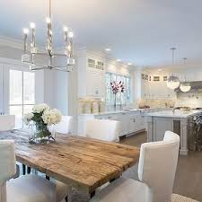 dining table interior design kitchen: the new white kitchen grey walls french doors salvaged rustic wood dining table grey kitchen island white marble countertops marble subway tiled