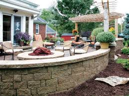 gallery outdoor living wall featuring: patio and fire pit featuring highland stonear wall system