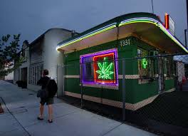 after medical legalization what are the costs of getting high a pedestrians walks past the little green pharmacy medical cannabis dispensary in denver colorado