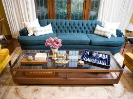 blue sofas living room: modern living room with blue sofa and poufs living room decorating