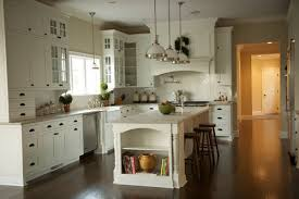 can you tell me about the light fixtures above the island and the kitchen sinkthx above sink lighting