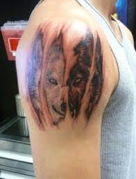 <b>Wolf</b> behind ripped <b>skin</b> | Cool tats | <b>Wolf</b> tattoo shoulder, <b>Wolf</b> face ...