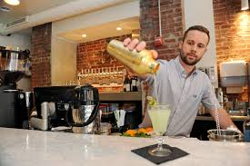 dooby s adds versatility to city s coffee culture baltimore bar bar manager josh sullivan pours a cucumberous at dooby s in mount vernon
