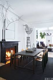 dining room designer furniture exclussive high: the dining table by jerame abel seguin is from ralph pucci the vintage chairs are by jean prouvac the photograph over the mantel is by catherine opie