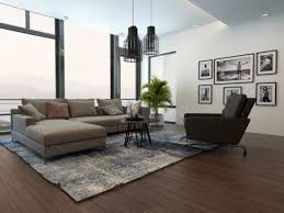 a plant rug coffee table sofa and chair are all necessary for a well functioning living roomshutterstock buy living room