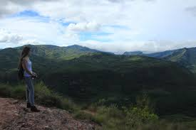 see the wonders of the world out tourist crowds out baggage a n w looks out at the andes mountains surrounding the el fuerte de samaipata pre