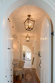 lantern light fixtures hall traditional with addition arched door archways built ins carpet runner hall storage beach house lighting fixtures