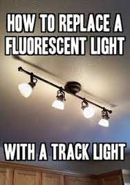 how to replace a fluorescent light with a track light simple tutorial cheap kitchen lighting ideas