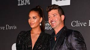 Robin Thicke, April Love Geary criticized for feeding <b>baby Hot</b> Cheetos