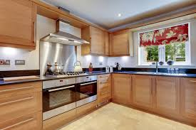 kitchen cabinets ceiling glossy surface wood grain cabinetry in modern kitchen