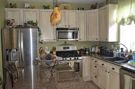 Painted Glazed Kitchen Cabinets White Glazed Cabinet Transformations A Review A Year Later