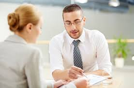 the best questions to ask a job interviewer  careers  us news a man points something out on paper