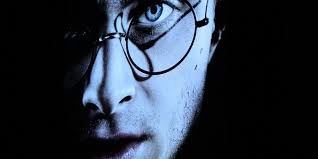 epic analysis of harry potter will change what you know about the close up portrait of danrad as harry potter looking grim his face partly