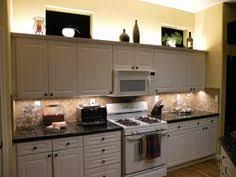 kitchen cabinets lighting and white led lights on pinterest cabinet lighting diy