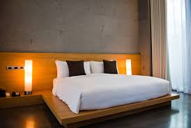 pictures simple bedroom: simple modern bedroom with wood paneling and platform bed