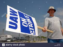 uaw protest on picket line against low wages and benefits stock photo uaw protest on picket line against low wages and benefits anti signs and work stoppage