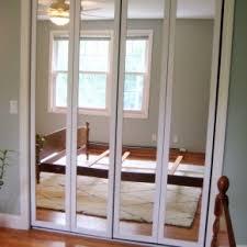 redoubtable triple mirrored closet doors panels as well as wide glass windows in admirable design mirrored closet door
