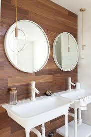 pendant modern bathroom lighting with double sink bathroom vanity under framed round mirror and wooden bathroom wall bathroom vanity pendant
