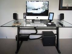 modern glass top computer desk design with white keyboard and speakers set also beautiful handle black idea and white wall paint color beautiful office desk glass