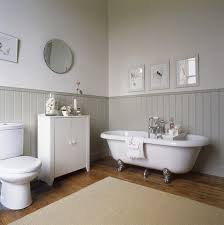 country bathroom colors: country bathroom cast iron tubbeadboard or woodpanellingon walls
