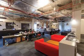 interior luxury advertising offices space with red microfiber sofa sets also maple wood coffee table and advertising office space