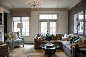 l interior ideas minimalist home living rooms presenting a cozy grey l shaped sofa arrangement and freestanding small round glass top coffee table on blue couches living rooms minimalist