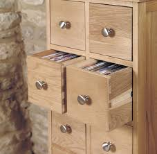 mobel oak drawer coffee table mobel oak multi drawer dvd cd storage chest chadwick satin lacquered oak hidden