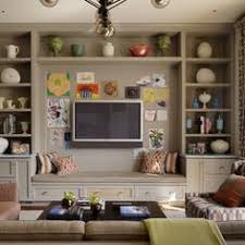 these built in cabinets provide good storage below behind the doors and display space above you could create a similar effect by purchasing bookshelves amusing create design office space